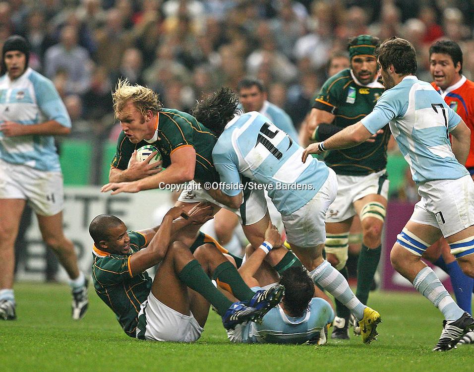 14/10/2007. Rugby World Cup. Semi Final. Argentina v South Africa. Francois Steyn is tackled by Ignacio Corleto. Saint Denis, France. ©Offside/Steve Bardens.