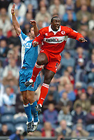 Photo: Back Page Images. 16/10/2004.<br /> Barclays Premiership. Blackburn Rovers v Middlesbrough. Ewood Park.<br /> Jimmy Floyd Hasselbaink gets up with Lucas Neill