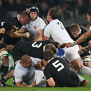 Players challenge at the breakdown during the New Zealand V France, Pool A match during the IRB Rugby World Cup tournament. Eden Park, Auckland, New Zealand, 24th September 2011. Photo Tim Clayton...