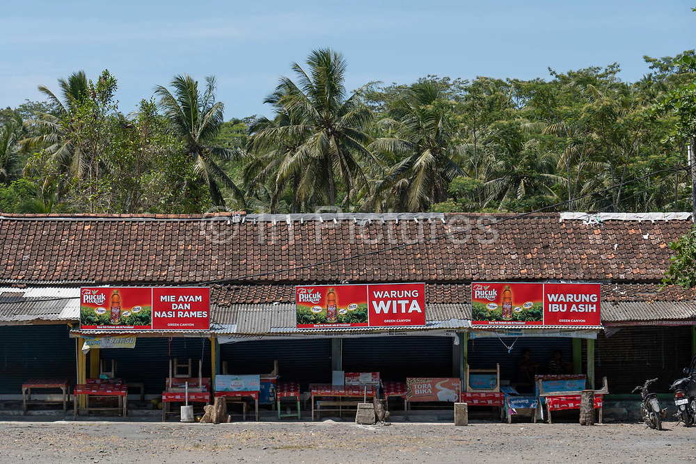 Low season at the Green Canyon food stalls near Pangandaran on the 30th October 2019 in Java in Indonesia.