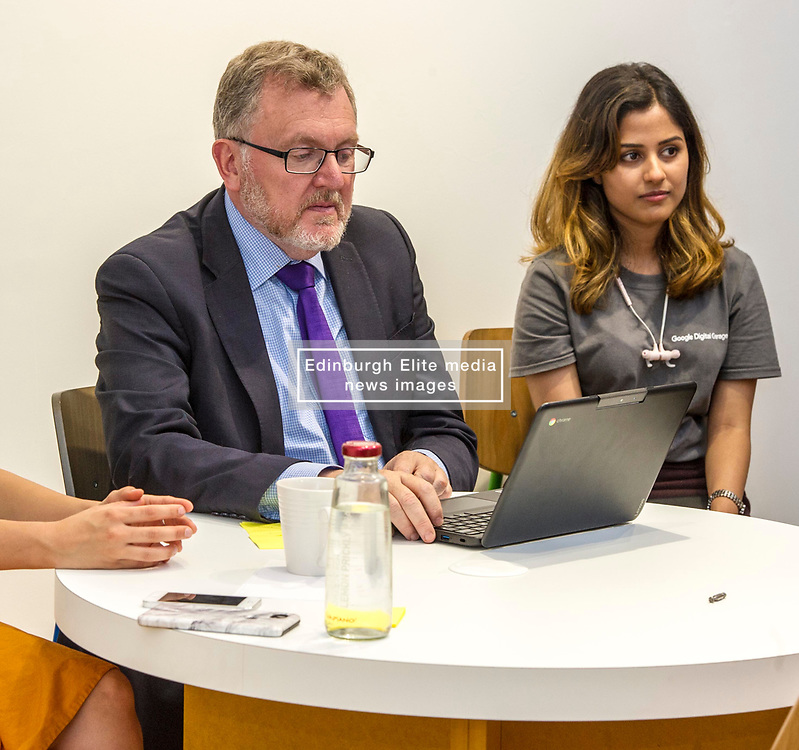 Pictured: David Mundell could rely on Team Leader Anikta Narayan to help out as he jined a session.<br /> <br /> Scottish Secretary David Mundell visited a 'digital garage' in Edinburgh which trains people in digital skills. The Google Digital Garage, in Shandwick Place is a social responsibility outlet for the corporate giant<br /> <br /> <br /> Ger Harley   EEm 23 July 2018