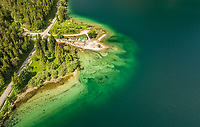 Aerial view of small sport grounds on Lago del Predil lake, Italy.
