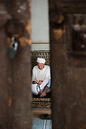 Old man praying in Fes el Bali, the old city, Morocco