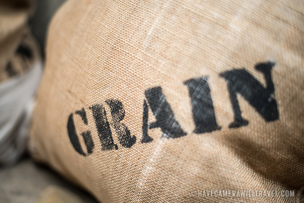 The word Feed stamped on a burlap pillow.