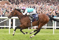 Frankel ridden by Tom Queally wins the JLT Lockinge Stakes Stakes during the Best of British Beer Festival & JLT Lockinge Stakes at Newbury Racecourse, Berkshire.