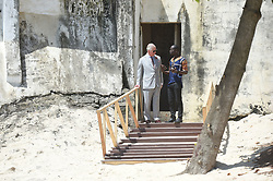 The Prince of Wales talks with Samuel Acquaah, Head of Education, Ghana Museums and Monuments Board, by a door once used by slaves as they were taken to waiting ships, during a visit to Osu Castle, also known as Fort Christiansborg in Accra, Ghana, on day four of his trip to west Africa with the Duchess of Cornwall.