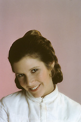 December 27, 2016 - File - CARRIE FRANCES FISHER (October 21, 1956 - December 27, 2016) was an American actress, screenwriter, author, producer, and speaker. She was known for playing Princess Leia in the Star Wars films. Fisher was also known for her semi-autobiographical novels, including Postcards from the Edge, and the screenplay for the film of the same name, as well as her autobiographical one-woman play, and its nonfiction book, Wishful Drinking, based on the show. Her other film roles included Shampoo (1975), The Blues Brothers (1980), Hannah and Her Sisters (1986), The 'Burbs (1989), and When Harry Met Sally (1989). Pictured: 1980's - London, United Kingdom, U.S. - Carrie FIsher as Princess Leia (Credit Image: © Lynn Goldsmith via ZUMA Press)