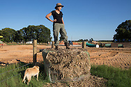 June 9, 2013, Sumner, Texas, Julia Trigg Crawford stands on a ball of hay overlooking the easement on her land that TransCanada  condemned by eminent domain in order to build the southern portion of the Keystone XL pipeline. Crawford is fighting TransCanada in court to stop the pipeline from crossing her land and though her case has not be heard, the construction of the southern end of the keystone XL continues.  President Obama will decide if the Northern route of the Keystone XL will be permitted in a couple.