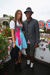 06.10.2013, Kaefers Wiesenschaenke, Muenchen, GER, der FC Bayern Muenchen beim Oktoberfest, im Bild David Alaba of Bayern Muenchen poses with Katja Butylina in front of the ensemble of the Bavaria statue, a monumental bronze sand-cast 19th-century statue and the Hall of Fame (Ruhmeshalle). The Bavaria is the female personification of the Bavarian homeland and by extension its strength and glory // during the Oktoberfest 2013 beer festival at Kaefers Wiesenschaenke in Munich, Germany on 2013/10/06. EXPA Pictures © 2013, PhotoCredit: EXPA/ Eibner/ Eckhard Eibner<br /> <br /> ***** ATTENTION - OUT OF GER *****