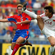 China's Weifeng Li tackles Costa Rica's Ronaldo Fonseca