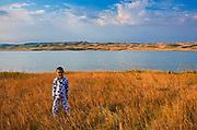 Boy and South Saskatchewan River at sunrise<br />Saskatchewan Landing Provincial Park<br />Saskatchewan<br />Canada