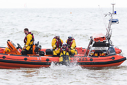 © Licensed to London News Pictures. 15/05/2016. Brighton, UK. A members of the Brighton RNLI collects and delivers ice creams for his team mates who are patrolling the sea off Brighton. Photo credit: Hugo Michiels/LNP