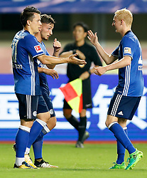 ZHUHAI, July 19, 2017 Yevhen Konoplyanka (L) of FC Schalke 04 celebrates scoring with his teammate Luke Hemmerich (R) during a pre-season soccer match between Bundesliga's FC Schalke 04 and Turkish Super League champion Besiktas JK at Zhuhai Sports Center Stadium in Zhuhai, south China's Guangdong Province, July 19, 2017. FC Schalke 04 won 3-2. (Credit Image: © Wang Lili/Xinhua via ZUMA Wire)