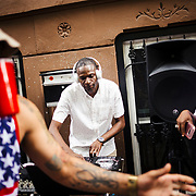 Dj Rob Rekshyt spins the records at a stoop party in Bedstuy, Brooklyn, New York on July 4, 2017. John Taggart for The New York Times.