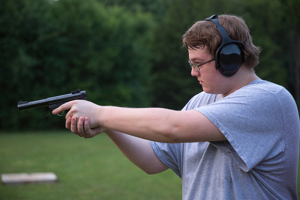 Young man at backyard shooting range in Tennessee.