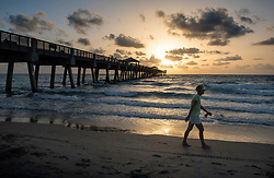 August 6, 2017 - Juno Beach, Florida, U.S. - Saharan dust passing over Florida in the last week influences the qualities of the sunrises and sunsets, like sunrise seen here at the Juno Beach Pier. (Credit Image: © Melanie Bell/The Palm Beach Post via ZUMA Wire)