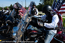 The start of the Jacket Ride, a fundraiser for veteran scholarships sponsored by Dennis Kirk. Riders met at the Joy Center on the Black Hills State University campus in Spearfish during the Sturgis Motorcycle Rally. SD, USA. Tuesday, August 10, 2021. Photography ©2021 Michael Lichter.