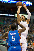 Dirk Nowitzki (41) of the Dallas Mavericks shoots the ball over Kendrick Perkins (5) of the Oklahoma City Thunder at the American Airlines Center in Dallas on Sunday, March 17, 2013. (Cooper Neill/The Dallas Morning News)