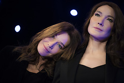 French-Italian model and singer Carla Bruni-Sarkozy poses next to a wax sculpture depecting herself during its inauguration on December 17, 2018 at the Musee Grevin wax museum in Paris. Photo by ABACAPRESS.COM