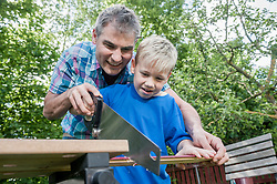 Working together handyman father son wood