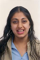 Portrait of teenage girl laughing,