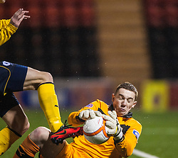Airdrie United's keeper Andrew Duncan saves at the feet of Falkirk's Lyle Taylor..Airdrie United 1 v 4 Falkirk, 22/12/2012..©Michael Schofield.