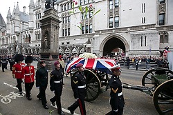 © Licensed to London News Pictures. 17/04/2013. London, United Kingdom. The funeral of Baroness Margaret Thatcher former British Prime Minister passes the Royal Courts of Justice,  for the service at St Paul Cathedral, London on the 17th April 2013. Photo credit LNP/Andrew Baker