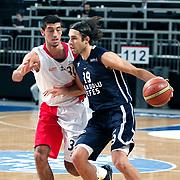 Anadolu Efes's Sasha Vujacıc (R) during their Turkish Basketball League match Anadolu Efes between Bandirma Kirmizi at Sinan Erdem Arena in Istanbul, Turkey, Saturday, December 24, 2011. Photo by TURKPIX