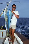 Charlie Murray with 25 lb 4 oz. mahi mahi, dorado or dolphin fish,Coryphaena hippurus, Cayman Angling Club Tournament, Grand Cayman, British West Indies ( Caribbean Sea )