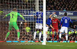 Liverpool's Fabinho (second right) heads the ball towards goal during the Premier League match at Goodison Park, Liverpool.