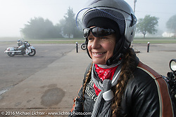 Cris Sommer Simmons on her 1934 Harley-Davidson VD at a gas stop during Cris Sommer Simmons on her 1934 Harley-Davidson VD at a gas stop after riding through the fog during stage 8 of the Motorcycle Cannonball Cross-Country Endurance Run, which on this day ran from Junction City, KS to Burlington, CO., USA. Saturday, September 13, 2014.  Photography ©2014 Michael Lichter.