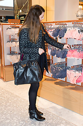 © Licensed to London News Pictures. 04/04/2016. A customer shopping at the new SELFRIDGES The Body Studio - the world's first fully integrated bodywear department and the largest retail space ever opened by the iconic London store. Covering over 37,000 sq ft, customers will experience over 3,000 brands and more than 5,000 different clothing options.London, UK. Photo credit: Ray Tang/LNP