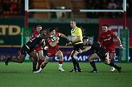 Gareth Davies of Scarlets © makes a break in the 2nd half but is stopped by a high tackle around his neck from Toulon's Semi Radradra Turagasoli Waqavatu  .  EPCR European Champions cup match, Scarlets v RC Toulon at the Parc y Scarlets in Llanelli, West Wales on Saturday 20th January 2018. <br /> pic by  Andrew Orchard, Andrew Orchard sports photography.