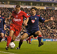 Photo. Jed Wee.Digitalsport<br /> Liverpool v Portsmouth, FA Barclaycard Premiership, Anfield, Liverpool. 17/03/2004.<br /> Liverpool's Michael Owen (L) takes on Portsmouth's Dejan Stefanovic.