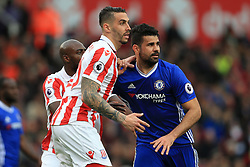 18th March 2017 - Premier League - Stoke City v Chelsea - Diego Costa of Chelsea grapples with Geoff Cameron of Stoke - Photo: Simon Stacpoole / Offside.