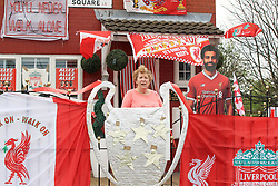 Emily Farley outside her home in Higham Square, Liverpool, which is decked out in Liverpool Football Club flags ahead of the UEFA Champions League final.