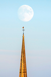 © Licensed to London News Pictures; 01/08/2020; Bristol, UK. A waxing moon is seen above the spire of St Mary Redcliffe church in Bristol city centre. The moon will be a full moon on Monday 03 August and is known as a Sturgeon Moon. Photo credit: Simon Chapman/LNP.