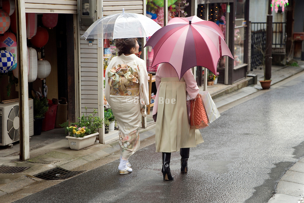 young girls in traditional Japanese dress walking together