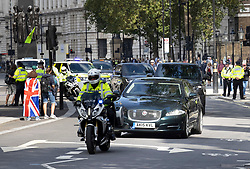 © Licensed to London News Pictures. 02/09/2020. London, UK. Prime Minister Boris Johnson's convoy speeds along Whitehall to a back entrance to Parliament to avoid protesters filling Parliament Square. Extinction Rebellion environmental protesters are taking part in a second day of action in central London. Photo credit: Peter Macdiarmid/LNP