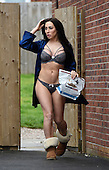 EXCLUSIVE Laura Alicia Summers caught out in her underwear putting the bins out.'