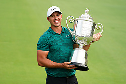 August 12, 2018 - St. Louis, Missouri, United States - Brooks Koepka holds the Wanamaker trophy after winning the 100th PGA Championship at Bellerive Country Club. (Credit Image: © Debby Wong via ZUMA Wire)