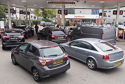 © Licensed to London News Pictures. 26/09/2021. London, UK. Motorists queue at a Sainsbury's petrol station in Alperton, West London as it reopen for fuel. There has been problems with the supply and distribution chain. Companies including BP and Shell have restricted deliveries due to the lack of HGV drivers. Photo credit: London News Pictures