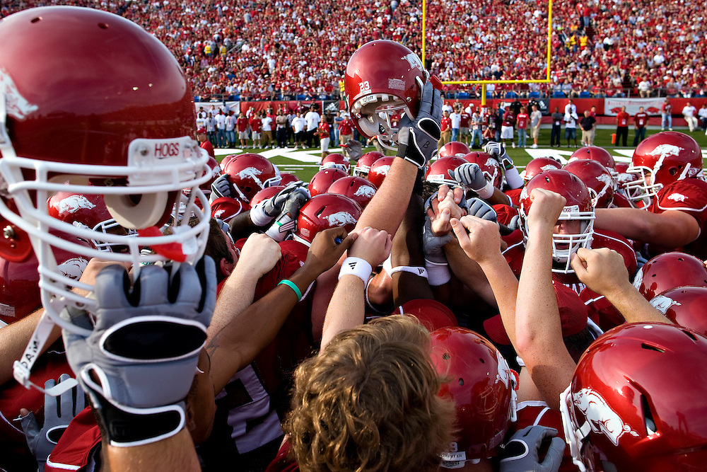 LITTLE ROCK, AR - SEPTEMBER 5:   The Arkansas Razorbacks huddle together before a game against the Missouri State Bears at War Memorial Stadium on September 5, 2009 in Little Rock, Arkansas.  The Razorbacks defeated the Bears 48-10.  (Photo by Wesley Hitt/Getty Images) *** Local Caption ***