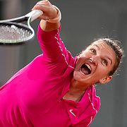 PARIS, FRANCE October 02. Simona Halep of Romania in action against Amanda Anisimova of the United States in the third round of the singles competition on Court Philippe-Chatrier during the French Open Tennis Tournament at Roland Garros on October 2nd 2020 in Paris, France. (Photo by Tim Clayton/Corbis via Getty Images)