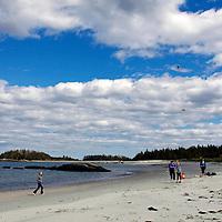 North America, Canada, Nova Scotia, Eastern Shore. Kite Flying on beach at Taylor Head Provinicial Park.
