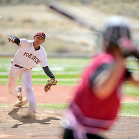 Tohatchi Cougar Brandon Lucero (2) releases a pitch to a Magdalena Steer at the Gallup Sports Complex Thursday.