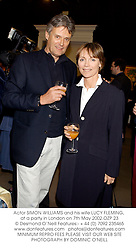 Actor SIMON WILLIAMS and his wife LUCY FLEMING, at a party in London on 7th May 2002.OZP 23