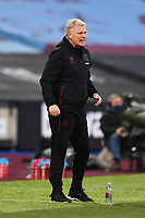 Football - 2020 / 2021 Premier League - West Ham United vs Brighton & Hove Albion - London Stadium<br /> <br /> West Ham United manager David Moyes shouts instructions to his team from the technical area.<br /> <br /> COLORSPORT/ASHLEY WESTERN