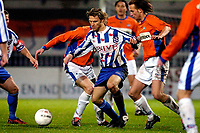 roosendaal - 20-11-2004 - rbc - heerenveen - holland casino eredivisie - seizoen 2004-2005 - de noor hestad in duel met voormalig teamgenoot paul de lange