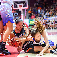 Gallup Bengal Hanna Toledo (13) and Bloomfield Bobcat Sierra Ortiz (25) tie up for a jump ball during a District 5A semifinal at The Pit in Albuquerque Thursday.  The Bengals fell to the Bobcats 59-56.